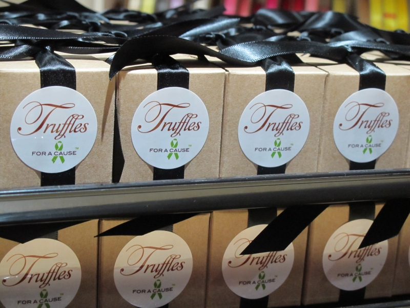 Black ribbons  on Kraft boxes with chocolate mini twist truffles inside.