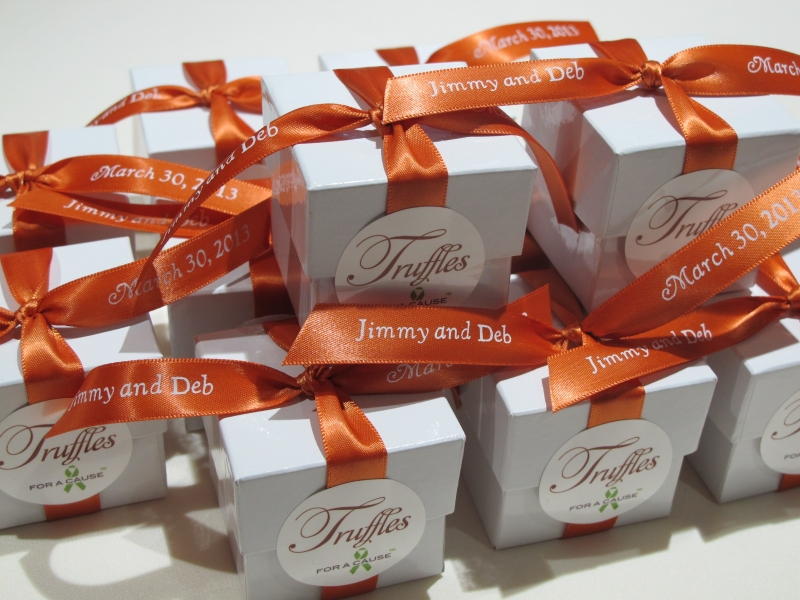 Burnt Sienna ribbons tied on white favor boxes with chocolate mini truffles inside.