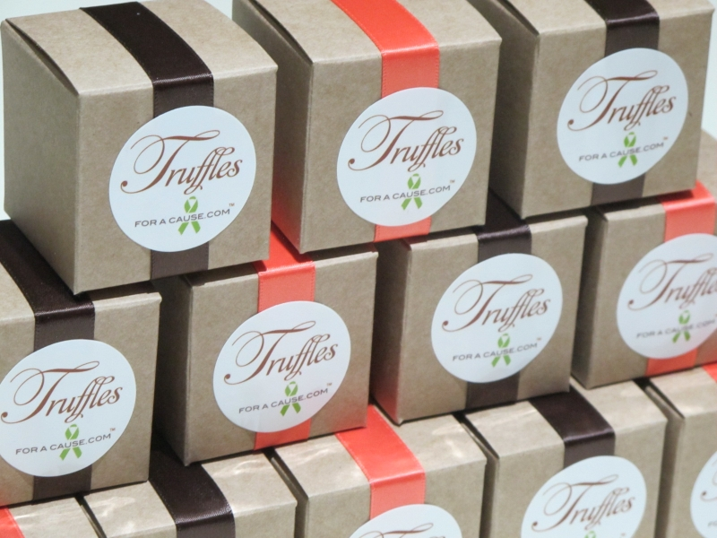 Coral & Brown ribbons tied modern style on Kraft boxes with chocolate mini truffles inside.