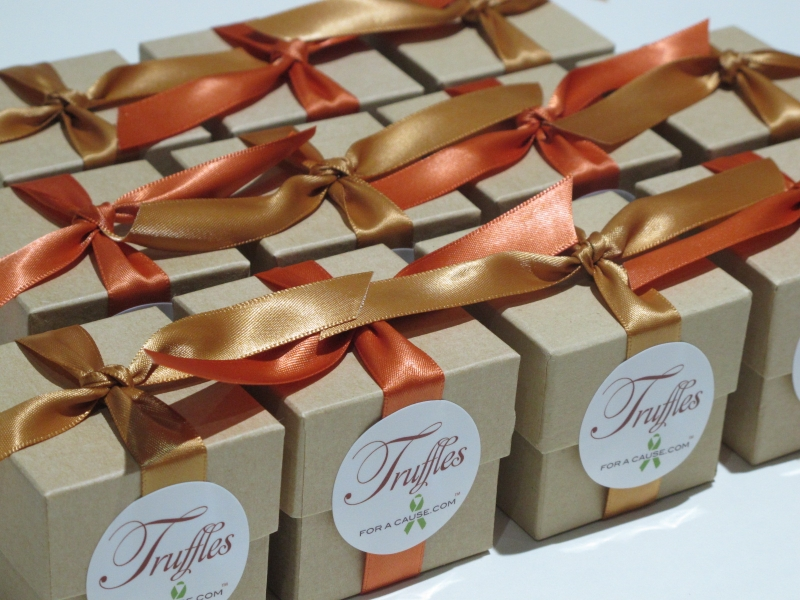 Gold &  Burnt Sienna ribbons on kraft favor boxes with chocolate mini truffles inside ready for shippig.