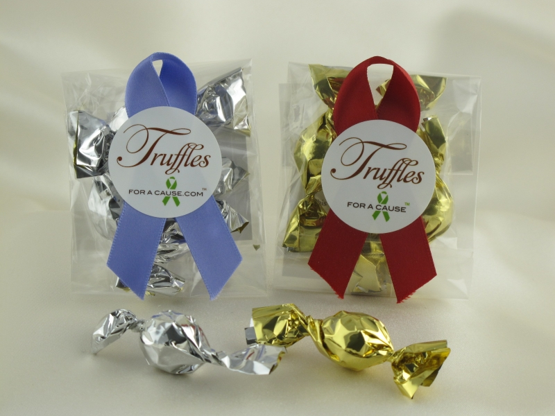 Mini Favors display with iris & scarlet ribbons and silver & gold chocolate mini truffles.