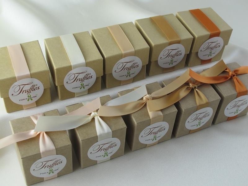 Peach, Ivory, Silk, Gold & Burnt Sienna ribbons on overhead kraft favor box display with various chocolate truffles inside.