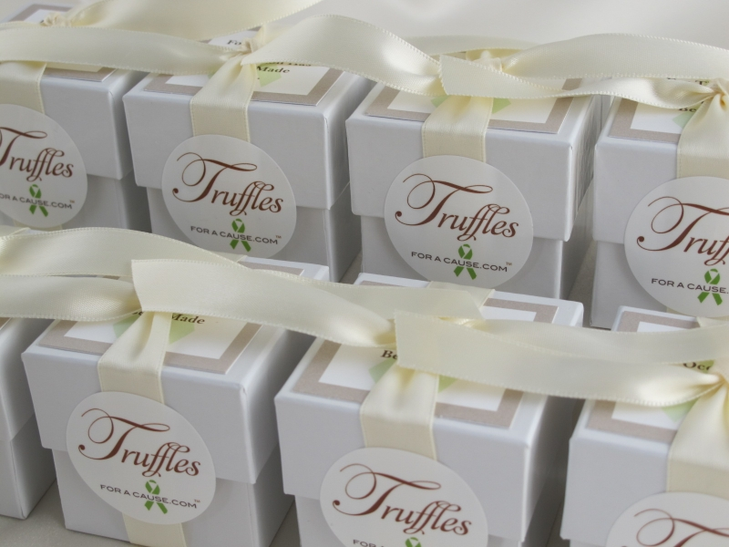 Plain white ribbons on white dessert favors with jumbo chocolate dessert truffles - stacked and ready for shipping.