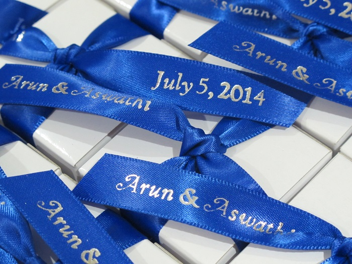 Close up of printed ribbons for Arun & Aswathi - chocolate wedding favors.