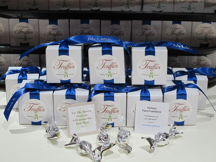 Boxed mini favor group with royal blue ribbons on white boxes - chocolate wedding favors.