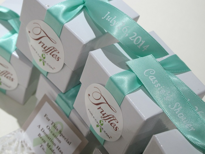 Close up of Cassie's Shower aqua ribbons - chocolate wedding favors for the American Red Cross.