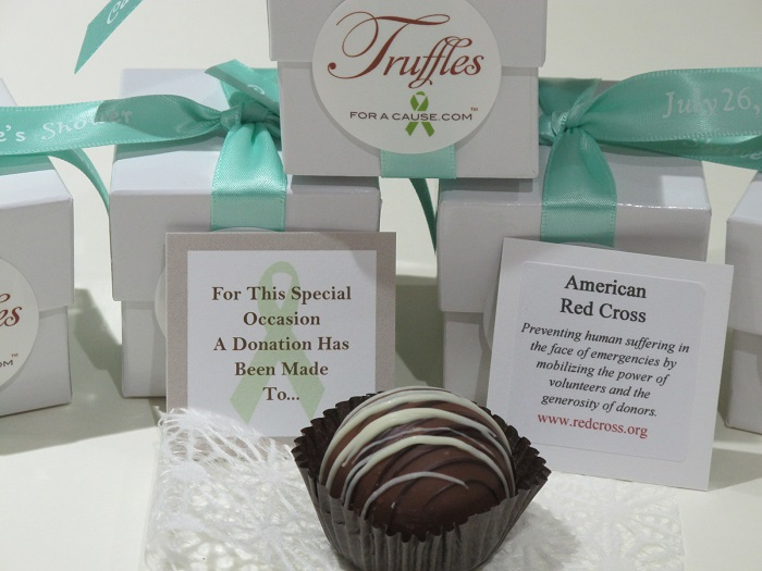 Group photo of aqua ribbons tied around white dessert favors in chocolate caramel - chocolate wedding favors for the American Red Cross.