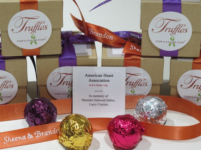 Charity donation as exampled by a close up of Sheena's foil assortment favors with natural kraft boxes and 4 assorted foil truffles.