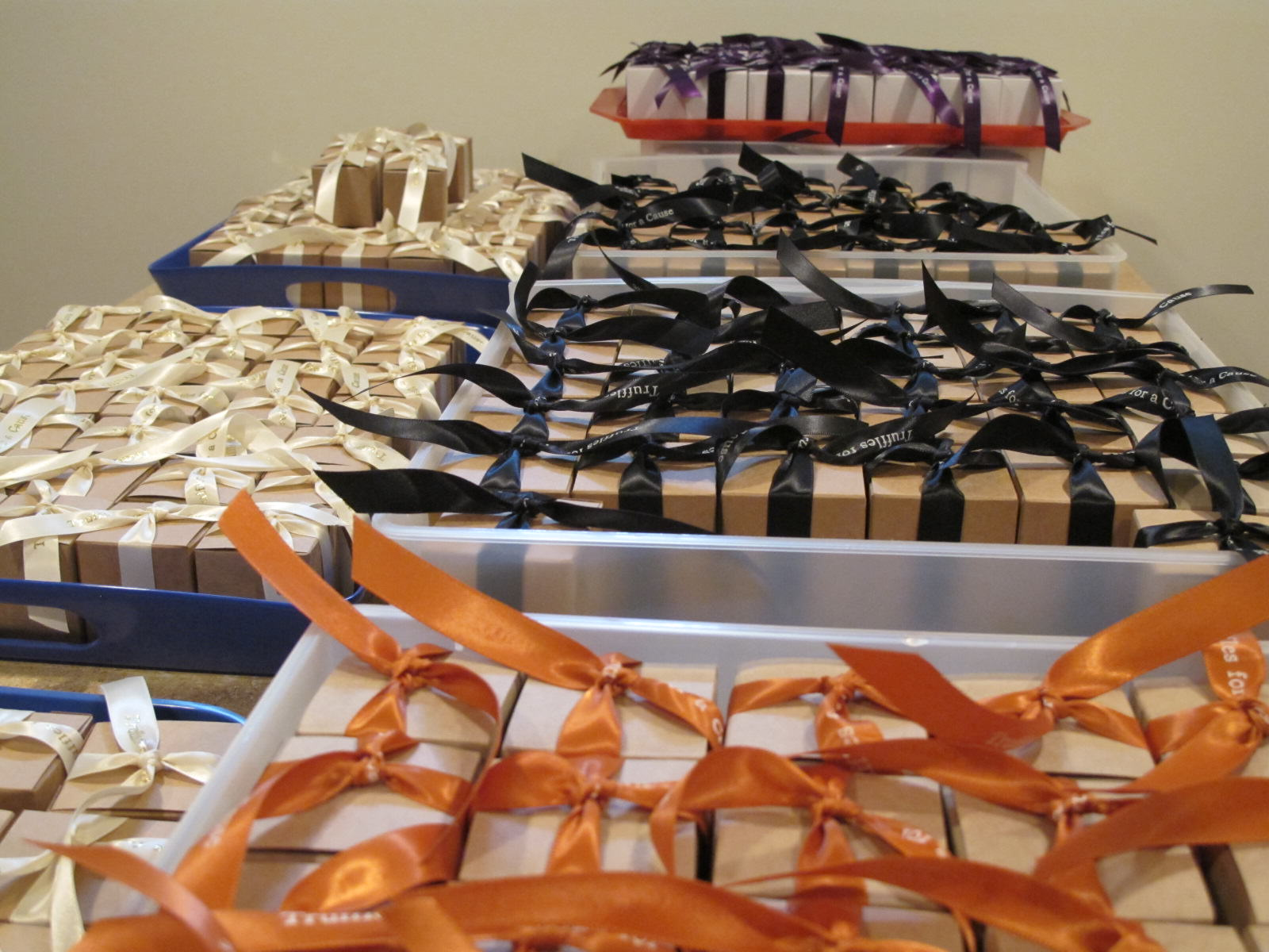 Composite view of multiple customer orders ready for shipping - all with chocolate mini truffles.