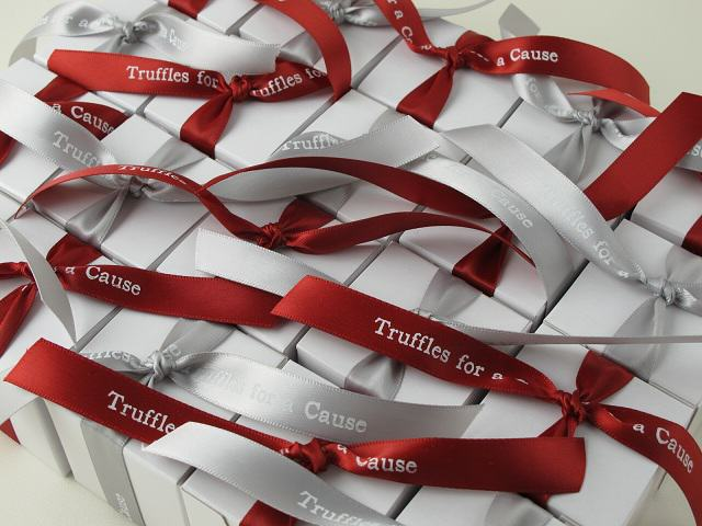 Interstitial Cystitis Network & Lupus Foundation - Silver & scarlet ribbons on white wedding favor boxes.