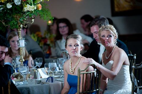 Shot of Christina & Mom at a table with wedding favors.