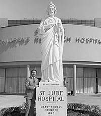 St Jude Children's Research Hospital - with Danny Thomas standing next to the St. Jude statue in front of the hospital.