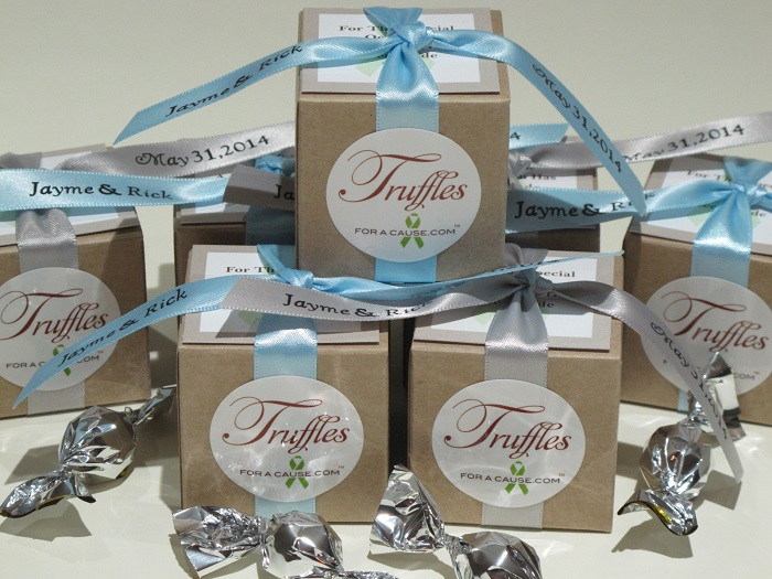 Donation to Wounded Warrior for Jayme & Rick's wedding favors with silver & light blue ribbons on natural kraft boxes.