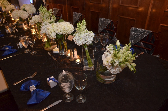 Table setting shot of Eric & Mallory's favor for their wedding charity donations to American Cancer & Make-A-Wish.