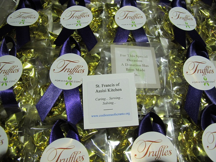 St Francis Assisi Kitchen - close up of charity card for for Ashley's Mini favors with milk chocolate truffles.