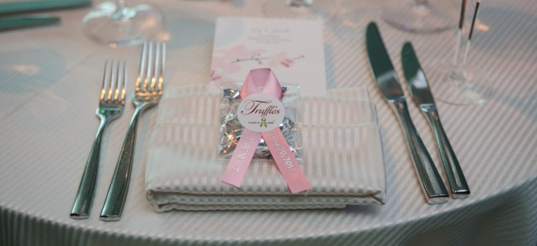 chocolate wedding favors (Mini Favor with pink ribbon), displayed at table setting.