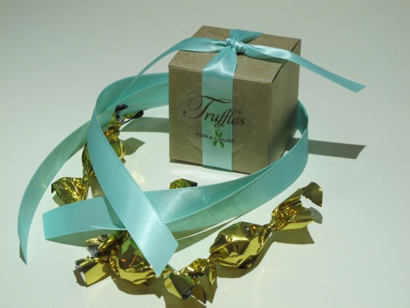 Aqua ribbons tied on kraft favor box with chocolate mini truffles inside.