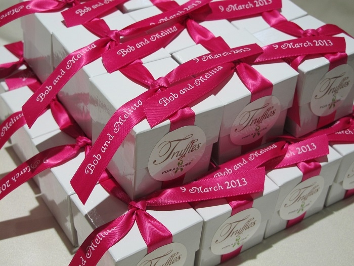 Azalea ribbons on white boxes with choccolate foil truffles inside.