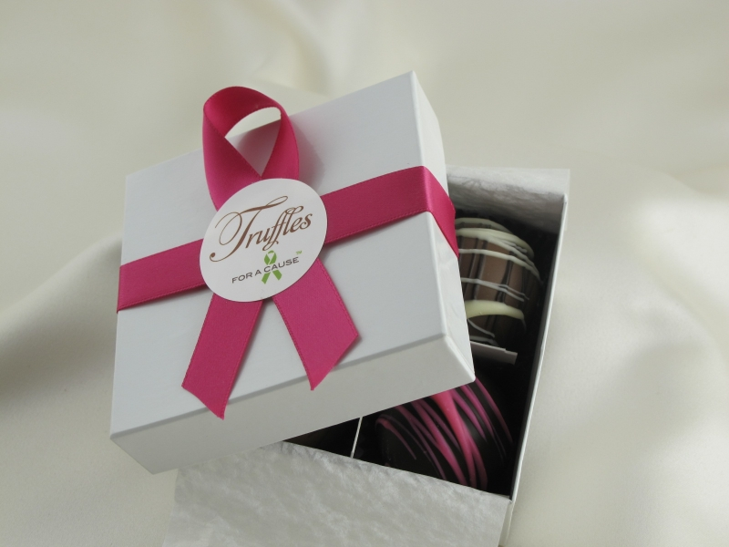 Deluxe Dessert Favor display box tied with an azalea ribbon with four chocolate dessert truffles inside.