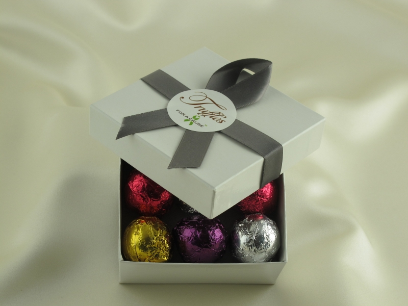 Deluxe Foil Favor display box tied with a pewter ribbon with 9 assorted chocolate foil truffles inside.