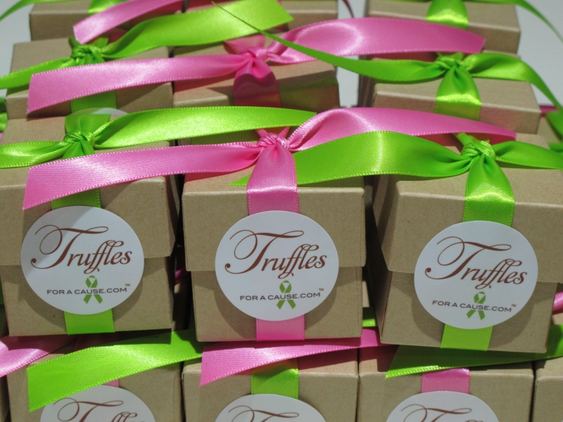 Hot Pink & New Chartreuse ribbons on kraft favor boxes with fuchsia & dark chocolate foil truffles inside.