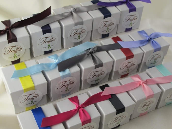 Mixed colors with modern & tradtional style ribbons on white boxed favors with chocolate truffles inside.