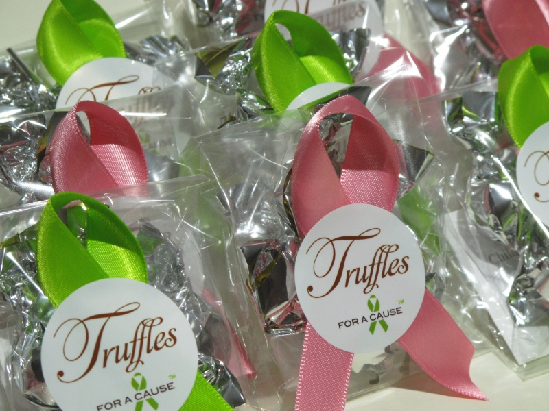 Watermelon & New Chartreuse ribbons on Mini Favors with silver foil chocolate mini truffles inside before shipping.